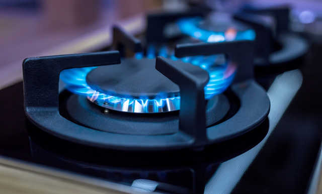 Stove. Cook stove. Modern kitchen stove with blue flames burning